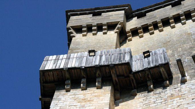 Hoarding on the keep of the Château de Castelnaud, Aquitaine, France.