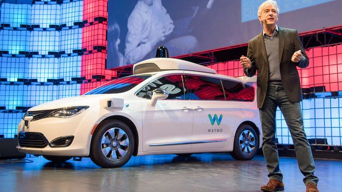 Waymo CEO John Krafcik, with Waymo's self-driving minivan.