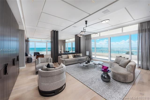 Living room that opens out to wraparound balcony
