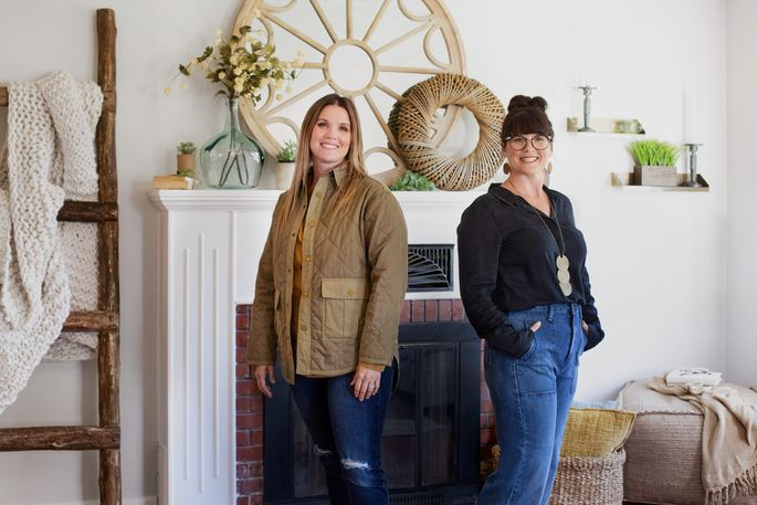 Leslie Davis, left, and her twin sister, Lyndsay Lamb, pose in the living room of a house they remodeled in Washington.