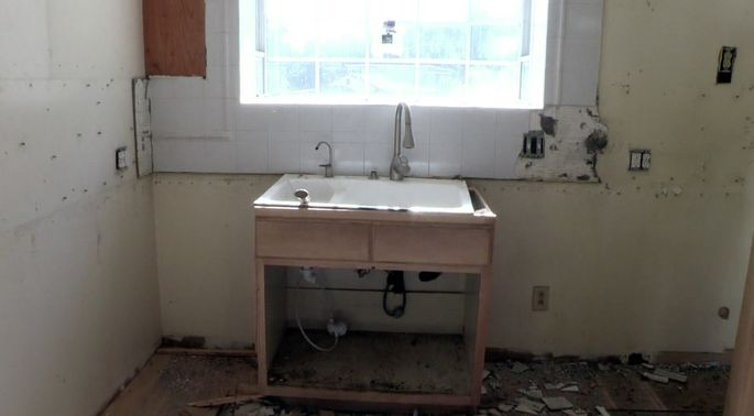 Remodeling an old kitchen doesn't come cheap—this is what happened once the show demolished the kitchen.