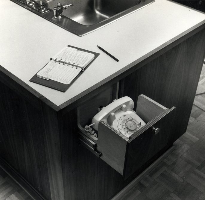 A phone drawer in the kitchen