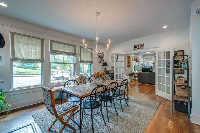Dining room with repurposed and restored French doors