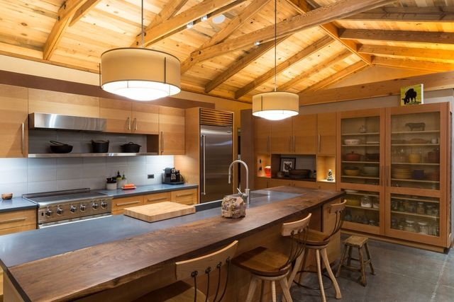Note the rock pyramid in this kitchen alcove, as well as the counters made of natural woods