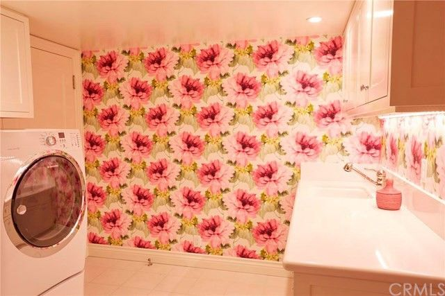 A floral wall greets you in the laundry room.