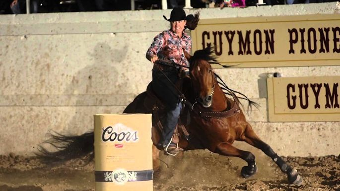 A cowgirl competes in the Guymon Pioneer Days Rodeo.