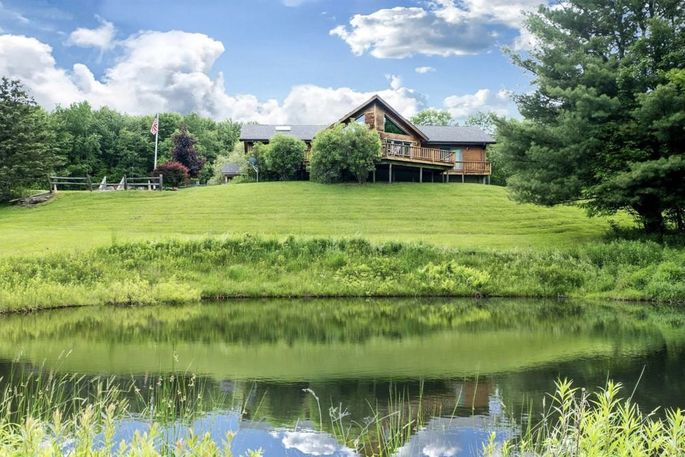 How to socially isolate in style: 10 acres, two ponds, and your own stream. A back-to-the-land dream house.