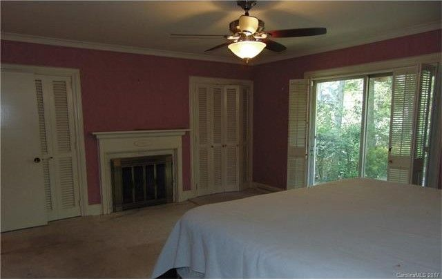 Pink paint couldn't liven up this gloomy bedroom.