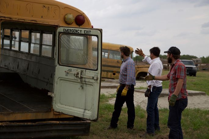 Before: Who could envision a living space made from two rusted-out school buses?