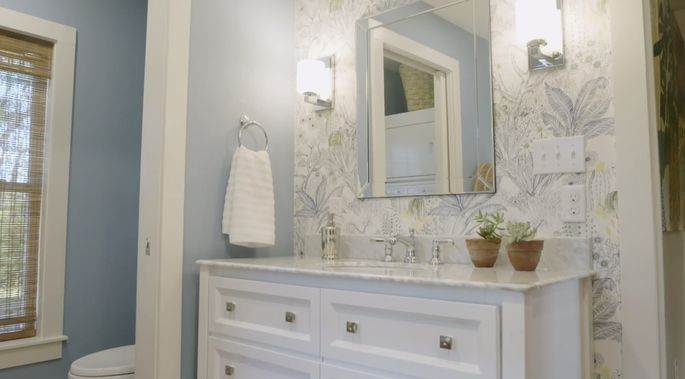 A little accent wallpaper can bring style to a boring bathroom.