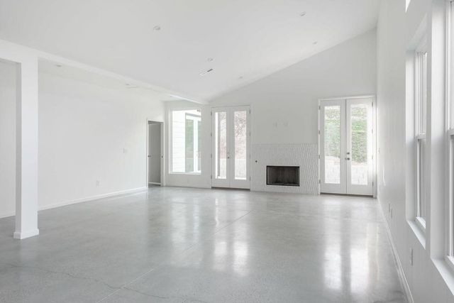 Open living and dining area with fireplace