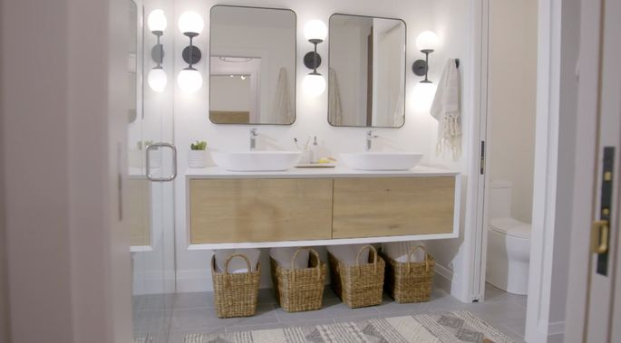 This floating vanity looks great in this modern bathroom!