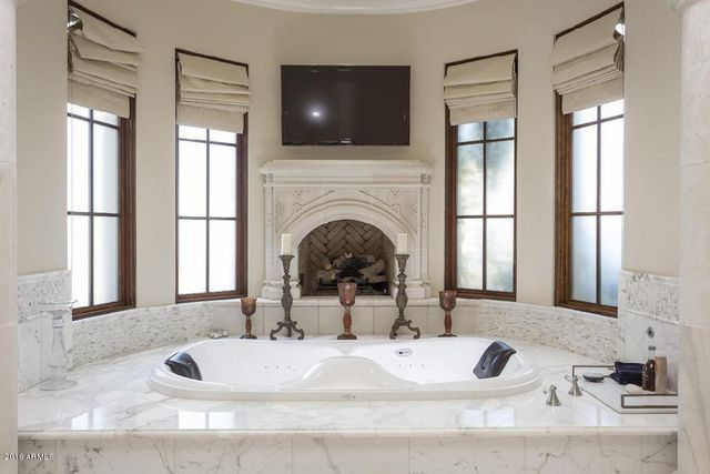 Master bathroom with spa and fireplace