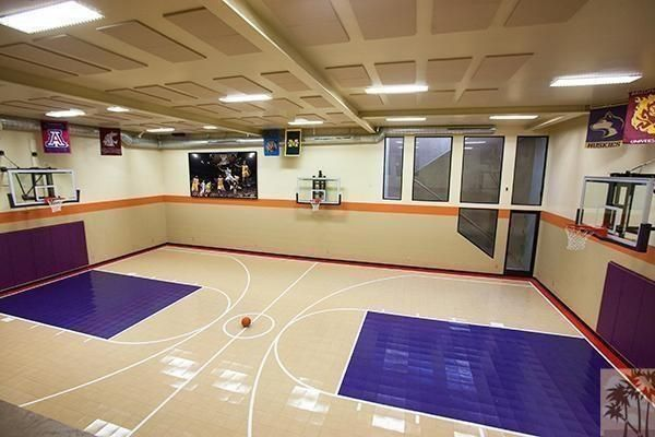 Hoop dreams seven homes with indoor basketball courts for Custom indoor basketball court