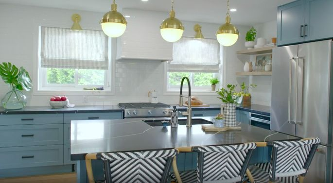 Black countertops go great with these blue cabinets.