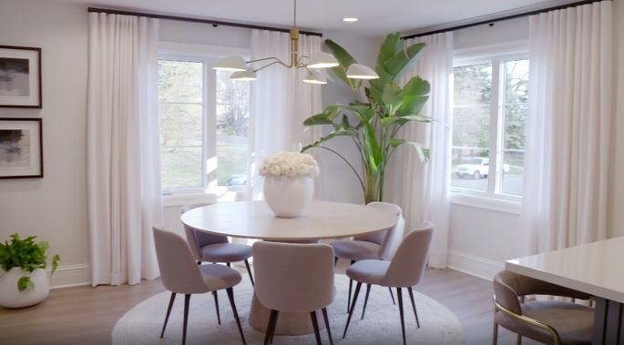 This chandelier looks amazing over this elegant dining table.
