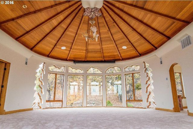 Room with windows shaped like trees and clouds