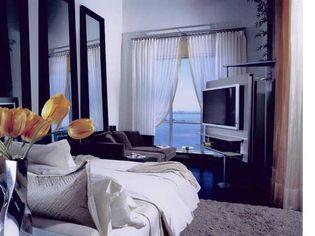 Juwan Howard Closes Fab Deal in South Beach