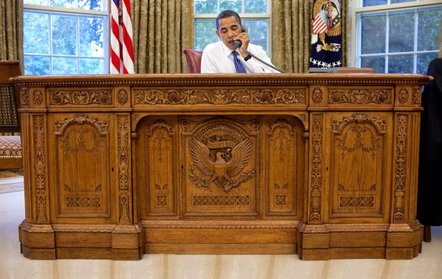 President Barack Obama behind the Resolute desk in the Oval Office