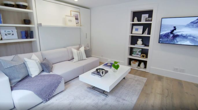 Who would have guessed this wall comes down to turn a living room into a bedroom?