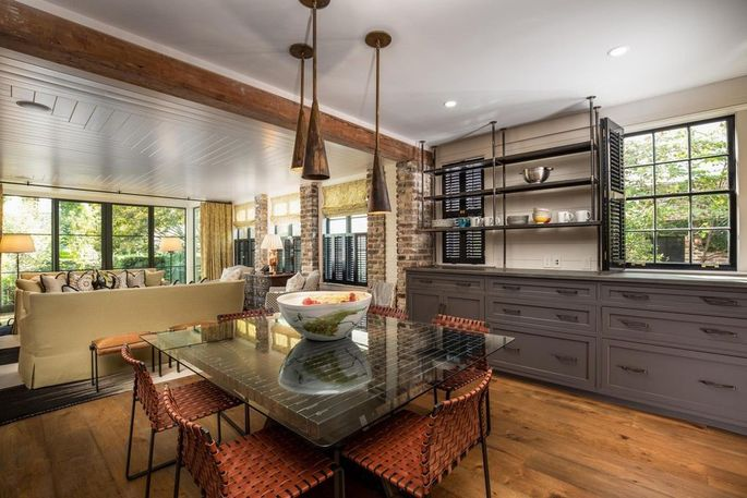 Dining area and family room with original brick wall