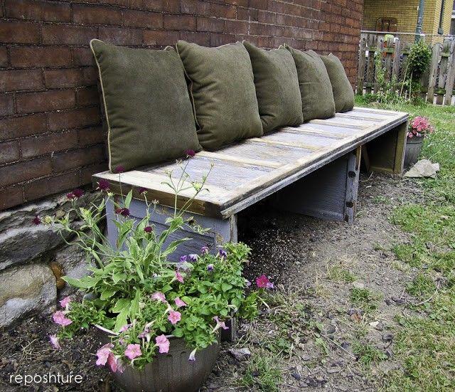 An old garage door, transformed into a gorgeous garden bench
