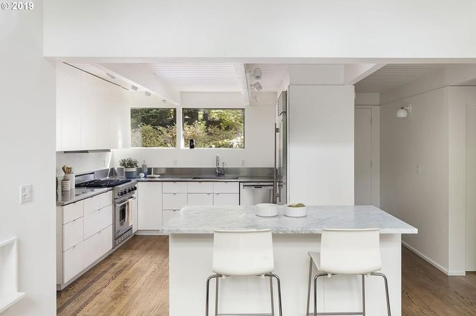 A clean, white kitchen is often attractive to buyers.