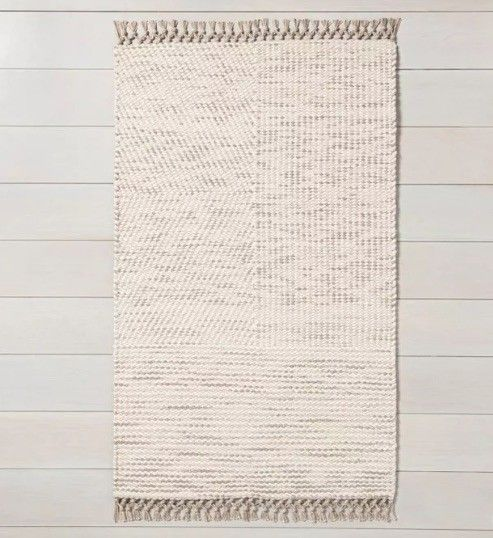 A classic neutral in wool and cotton to warm your room