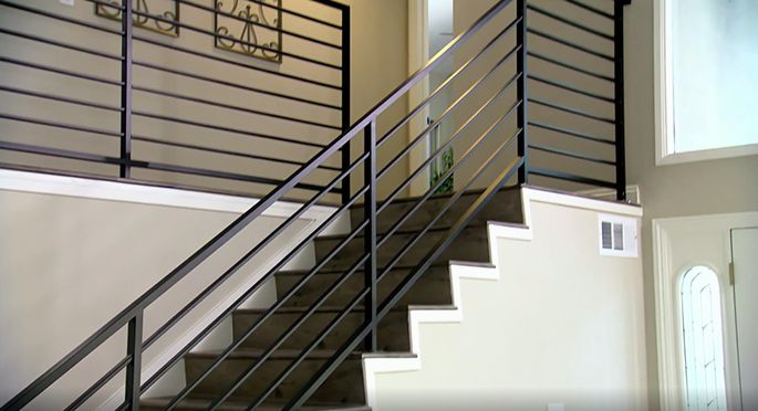 This sleek railing is a big improvement on the outdated version that came with the house.