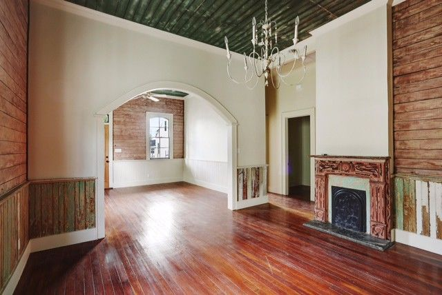 Reclaimed wood makes up the ceiling and wainscoting of this living room in  Holy Cross. - Restoring New Orleans By Building On Its Past Realtor.com®