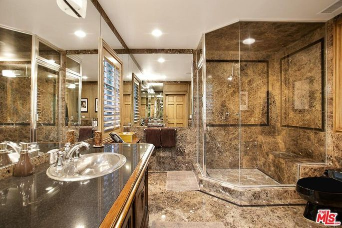 Brown marble and polished wood bathroom
