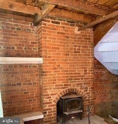 Exposed brick and fireplace
