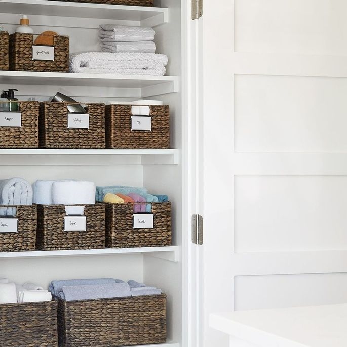 An organized bathroom closet will bring peace to your whole space.
