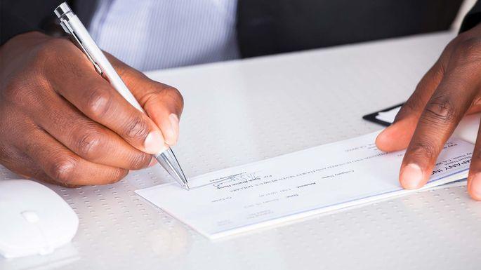 signing-paycheck