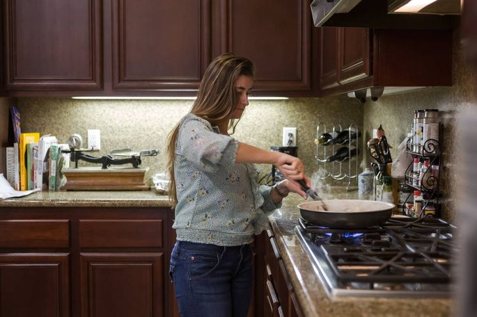 Ms. Hering cooks in the kitchen of her newly purchased home.