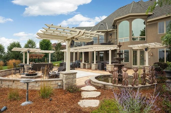 Patio with hot tub, fire pit, and dance floor