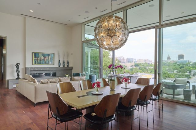 The living and dining area of the Sharplin home in Austin has sliding glass doors and 14-foot-high ceilings.