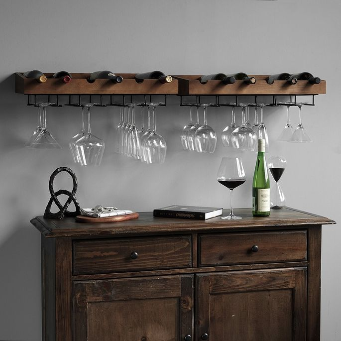Store wine and glasses together over a chest or table for an instant bar.