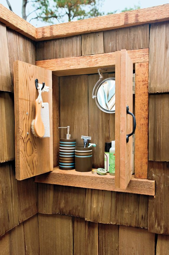 A wooden outdoor medicine cabinet is great to hold all your shower must-haves.