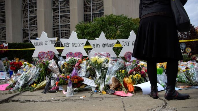 Mourners visit the memorial outside the Tree of Life Synagogue
