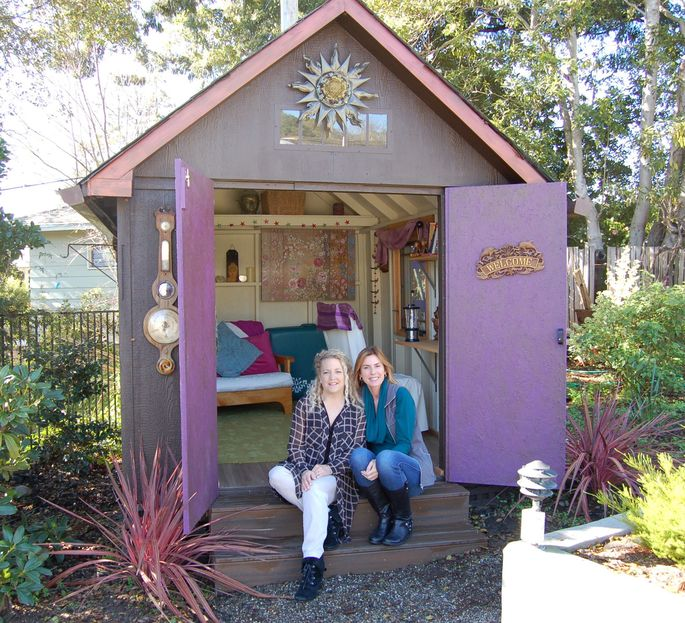 A shed kit from Costco that Erika Kotite (left, with sister-in-law Karin Nystrom) personalized with whimsical touches