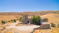 Massive Stone Castle in the Mojave Desert Needs a Buyer in Shining Armor