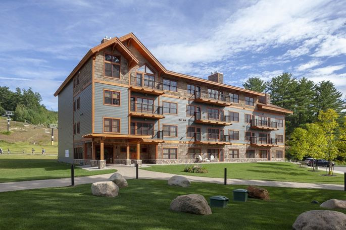 The slope-side Kearsarge Brook condominium complex is part of a multiyear, $50 million development at Cranmore Mountain Resort.