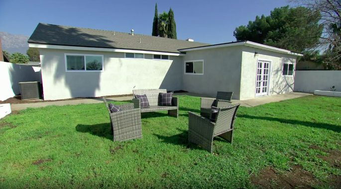 While this yard may look much better, there's still some unsightly dirt patches.