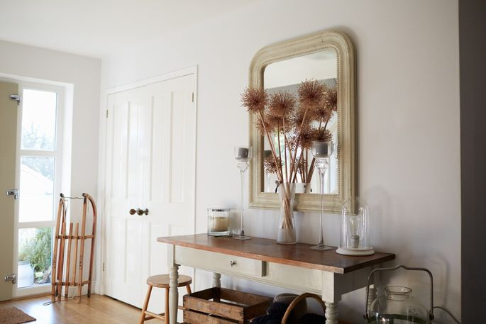 A mirror in your entryway helps you check your appearance before you fly out the door.