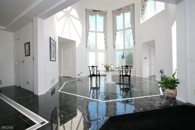 Two-story, marble foyer