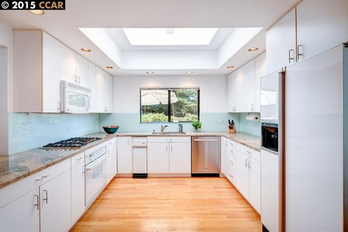The original kitchen was galley style with typical amenities.