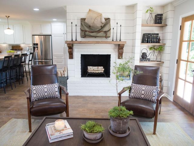 The shiplap covered fireplace