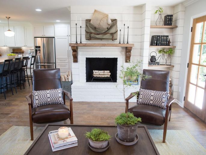A shiplap-covered fireplace wall