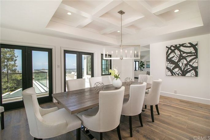 Formal dining room with coffered ceiling